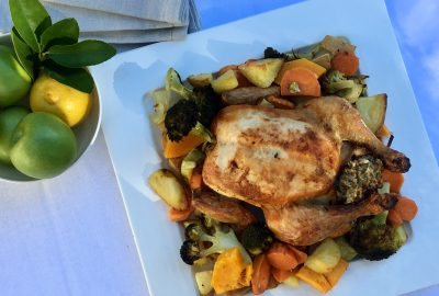 Roast chicken with sage and apple stuffing and roasted vegetable medley